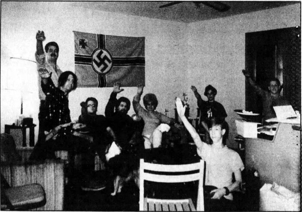 Photo confiscated by FBI from Jonathan David Brown's residence. Brown is seated at left.